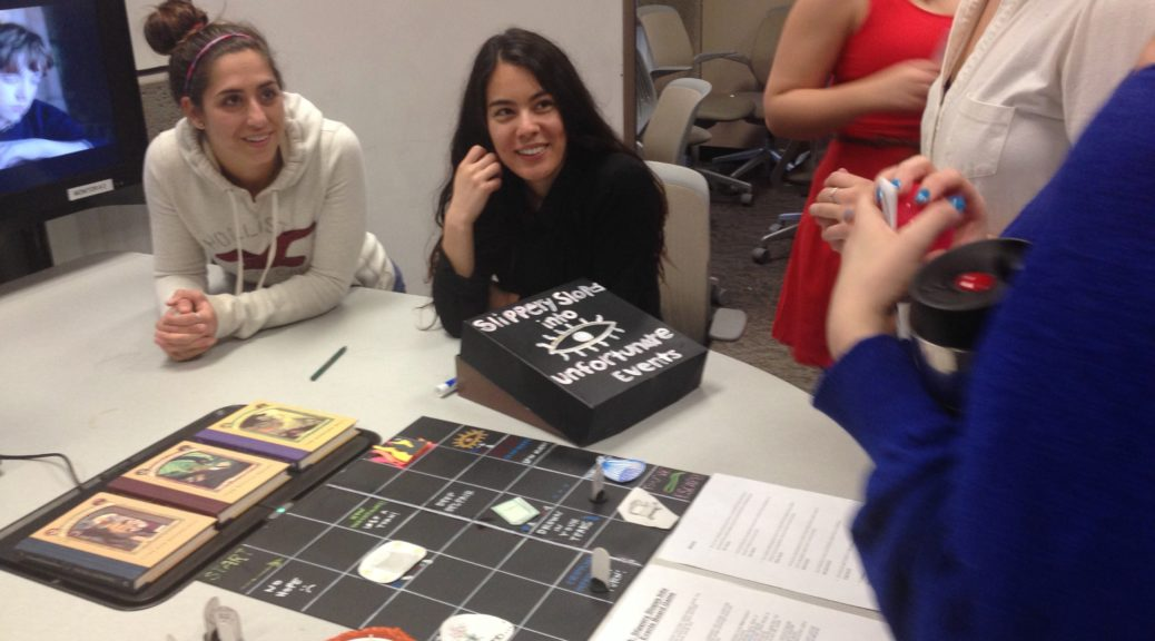 students sitting around a game
