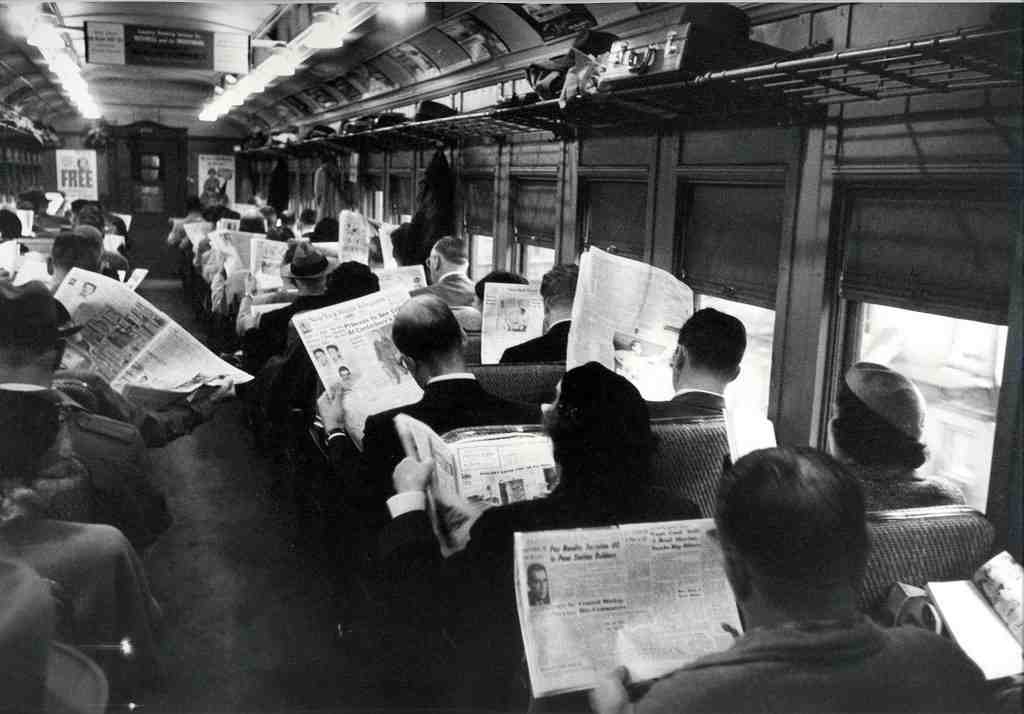 black and white photo of people on a train in the 1940s